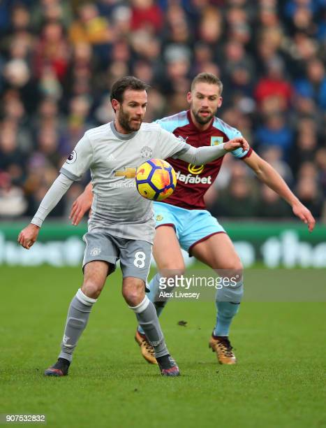 Juan Mata of Manchester United and Charlie Taylor of Burnley battle for the ball during the Premier League match between Burnley and Manchester...