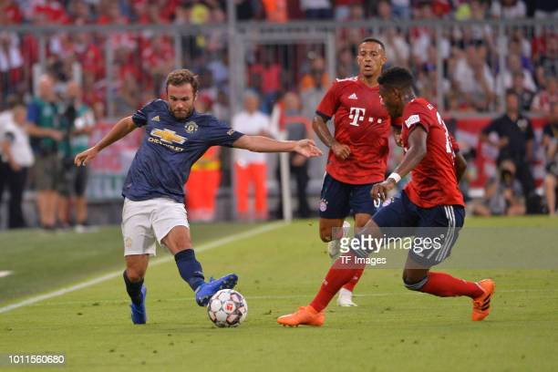 Juan Mata of Manchester United and David Alaba of Bayern Muenchen battle for the ball during the friendly match between Bayern Muenchen and...