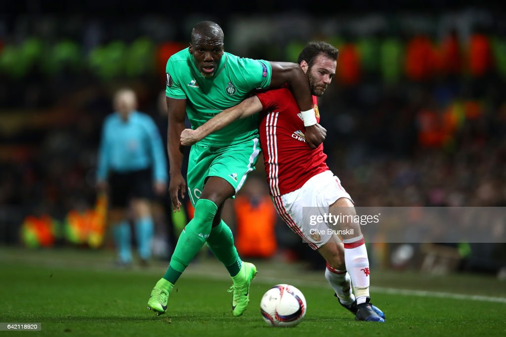 Juan Mata of Manchester United and Florentin Pogba of Saint-Etienne in action during the UEFA Europa League Round of 32 first leg match between Manchester United and AS Saint-Etienne at Old Trafford on February 16, 2017 in Manchester, United Kingdom.