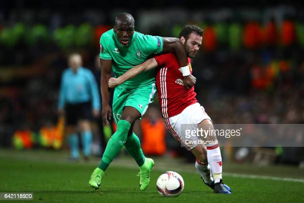 Juan Mata of Manchester United and Florentin Pogba of Saint-Etienne in action during the UEFA Europa League Round of 32 first leg match between...