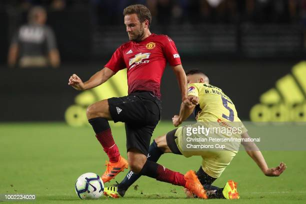 Juan Mata of Manchester United and Guido Rodriguez of Club America in action during the International Champions Cup game at the University of Phoenix...