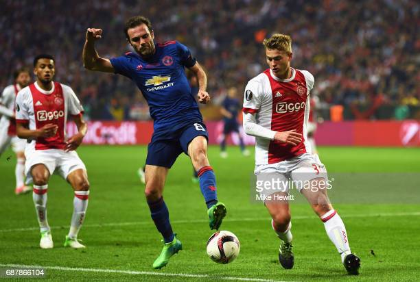 Juan Mata of Manchester United and Joel Veltman of Ajax in action during the UEFA Europa League Final between Ajax and Manchester United at Friends...