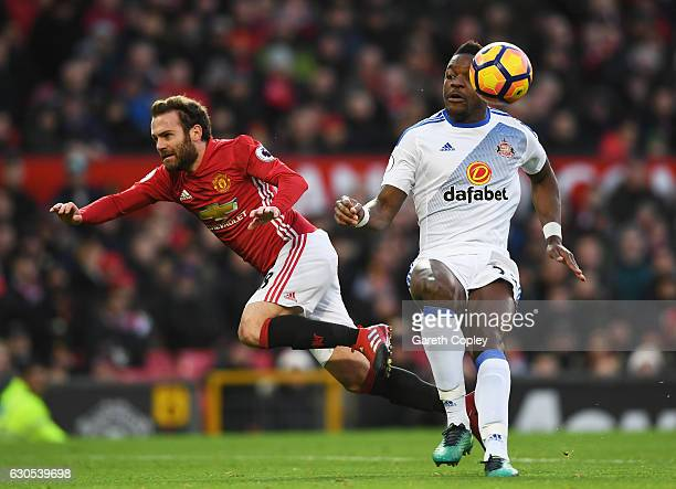 Juan Mata of Manchester United and Lamine Koné of Sunderland collide during the Premier League match between Manchester United and Sunderland at Old...
