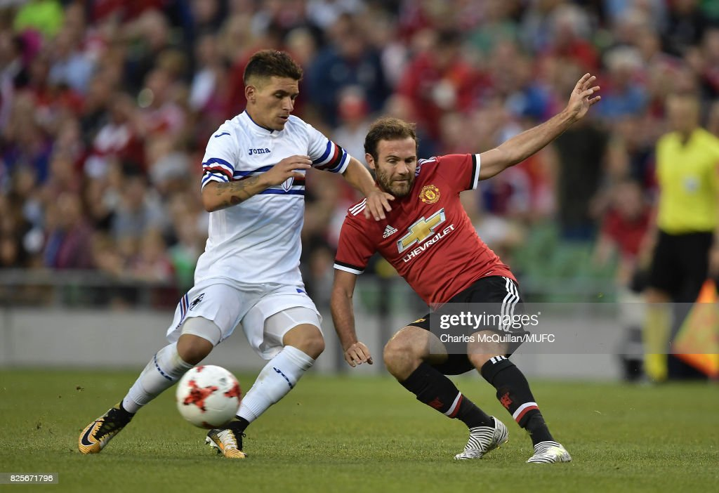 Juan Mata of Manchester United and Lucas Torreira of Sampdoria during the Aon Tour pre season friendly game between Manchester United and Sampdoria at Aviva Stadium on August 2, 2017 in Dublin, Ireland.