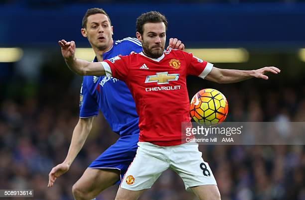 Juan Mata of Manchester United and Nemanja Matic of Chelsea compete during the Barclays Premier League match between Chelsea and Manchester United at...