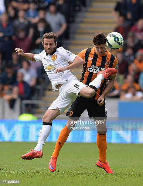 Juan Mata of Manchester United and Robbie Brady of Hull City compete for the ball during the Barclays Premier League match between Hull City and...
