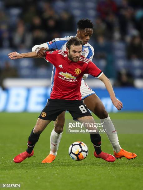 Juan Mata of Manchester United and Terence Kongolo of Huddersfield Town during the Emirates FA Cup Fifth Round match at The John Smiths Stadium on...