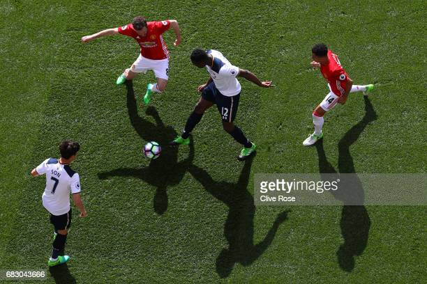 Juan Mata of Manchester United and Victor Wanyama of Tottenham Hotspur battle for possession during the Premier League match between Tottenham...
