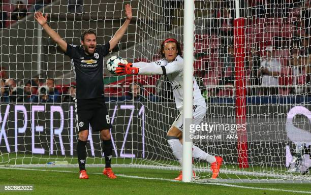 Juan Mata of Manchester United appeals after goalkeeper Mile Svilar of Benfica fails to stop the ball crossing the line during the UEFA Champions...
