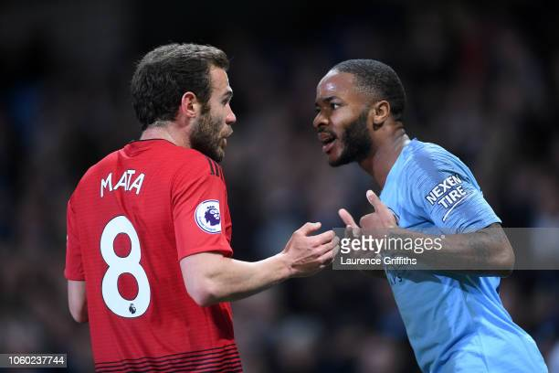 Juan Mata of Manchester United argues with Raheem Sterling of Manchester City after the Premier League match between Manchester City and Manchester...