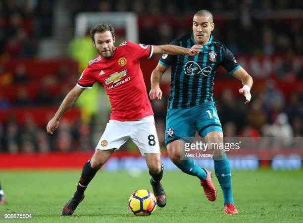 Juan Mata of Manchester United beats Oriol Romeu of Southampton during the Premier League match between Manchester United and Southampton at Old...