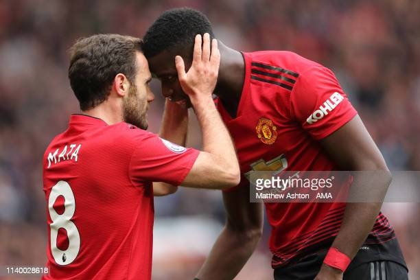 Juan Mata of Manchester United celebrates after scoring a goal to make it 10 with Paul Pogba during the Premier League match between Manchester...