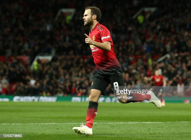 Juan Mata of Manchester United celebrates after scoring his team's first goal during the Carabao Cup Third Round match between Manchester United and...