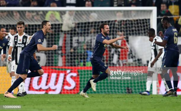 Juan Mata of Manchester United celebrates after scoring his team's first goal during the UEFA Champions League Group H match between Juventus and...