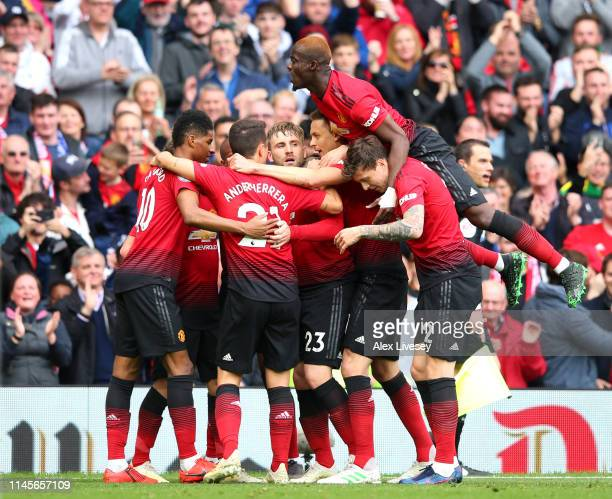 Juan Mata of Manchester United celebrates after scoring his team's first goal with Eric Bailly and team mates during the Premier League match between...