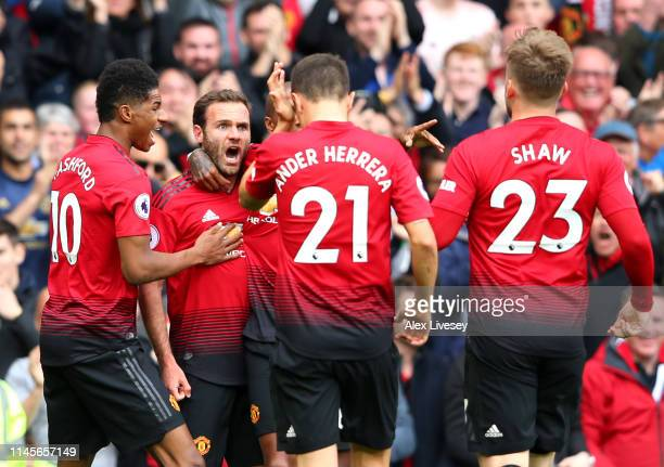 Juan Mata of Manchester United celebrates after scoring his team's first goal with team mates during the Premier League match between Manchester...