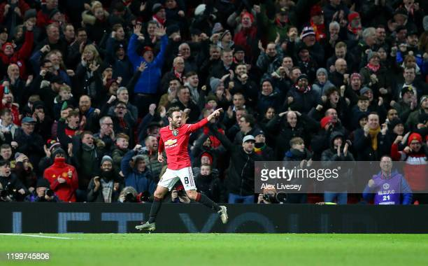 Juan Mata of Manchester United celebrates after scoring his team's first goal during the FA Cup Third Round Replay match between Manchester United...