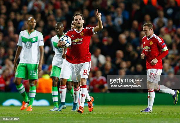 Juan Mata of Manchester United celebrates as he scores their first and equalising goal from the penalty spot during the UEFA Champions League Group B...