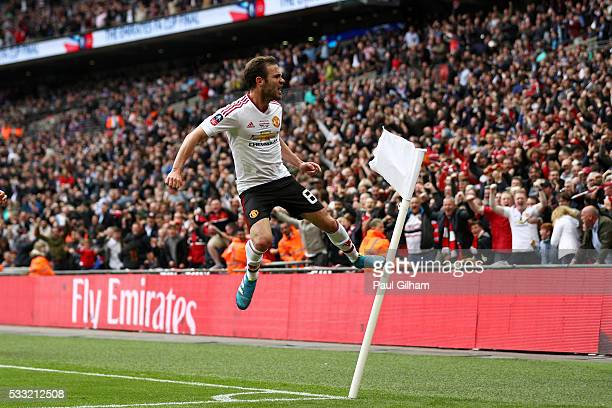 Juan Mata of Manchester United celebrates as he scores their first goal during The Emirates FA Cup Final match between Manchester United and Crystal...