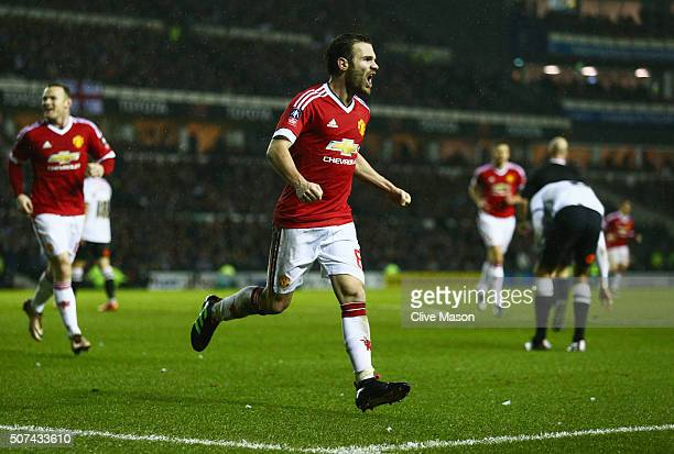 Juan Mata of Manchester United celebrates as he scores their third goal during the Emirates FA Cup fourth round match between Derby County and...