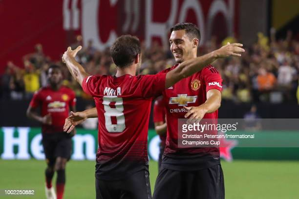 Juan Mata of Manchester United celebrates his goal with Matteo Darmian during the second half of the International Champions Cup game against the...