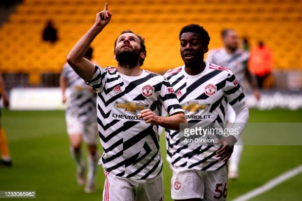 Juan Mata of Manchester United celebrates scoring a goal to make the score 1-2 during the Premier League match between Wolverhampton Wanderers and...