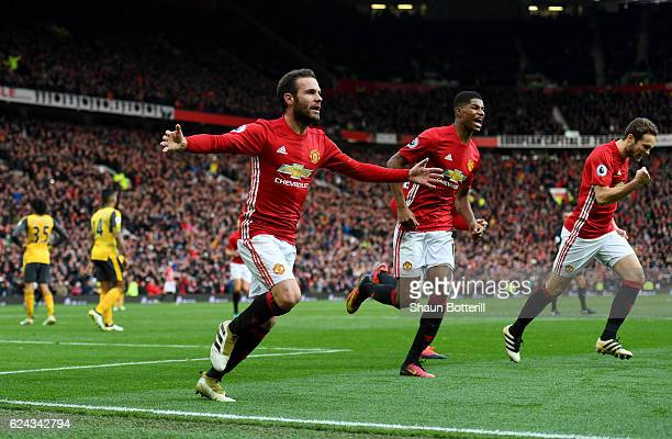 Juan Mata of Manchester United celebrates scoring his sides first goal during the Premier League match between Manchester United and Arsenal at Old...