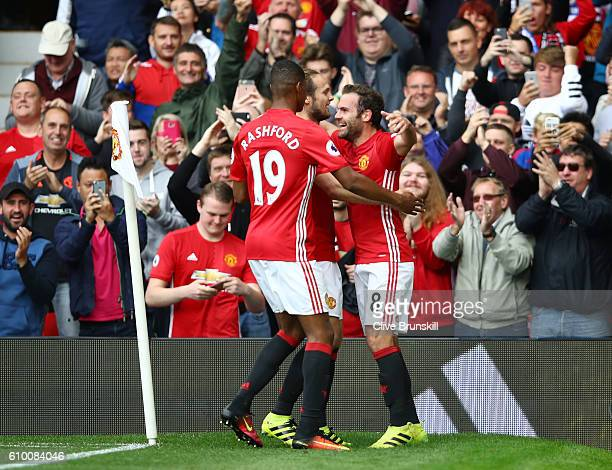 Juan Mata of Manchester United celebrates scoring his sides second goal with Marcus Rashford of Manchester United during the Premier League match...