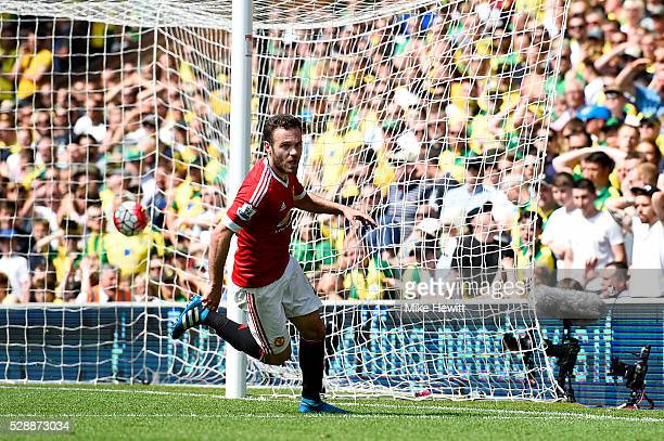 Juan Mata of Manchester United celebrates scoring his team's first goal during the Barclays Premier League match between Norwich City and Manchester...