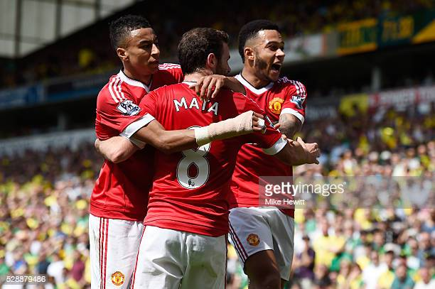 Juan Mata of Manchester United celebrates scoring his team's first goal with his team mates Jesse Lingard and Memphis Depay during the Barclays...