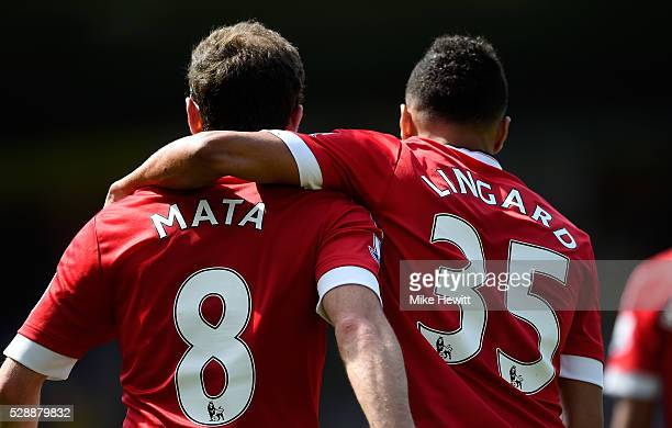 Juan Mata of Manchester United celebrates scoring his team's first goal with his team mate Jesse Lingard during the Barclays Premier League match...
