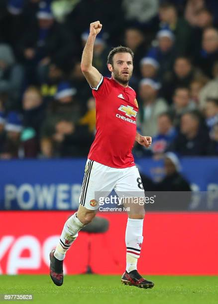 Juan Mata of Manchester United celebrates scoring his team's opening goal during the Premier League match between Leicester City and Manchester...