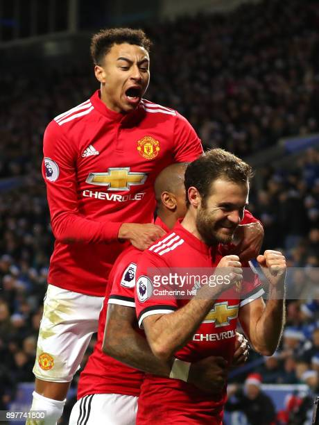 Juan Mata of Manchester United celebrates scoring his team's second goal with Jesse Lingard during the Premier League match between Leicester City...