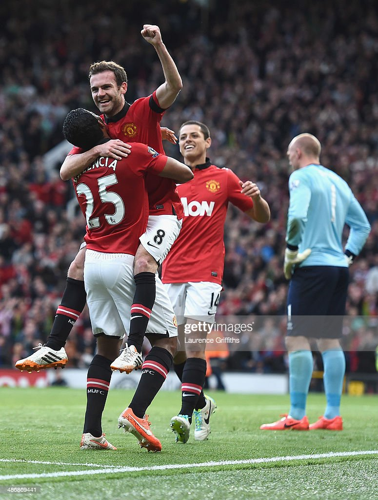 Juan Mata of Manchester United celebrates scoring the fourth goal during the Barclays Premier League match between Manchester United and Norwich City at Old Trafford on April 26, 2014 in Manchester, England.
