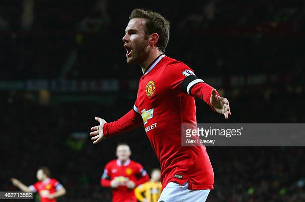 Juan Mata of Manchester United celebrates scoring the opening goal during the FA Cup Fourth round replay match between Manchester United and...