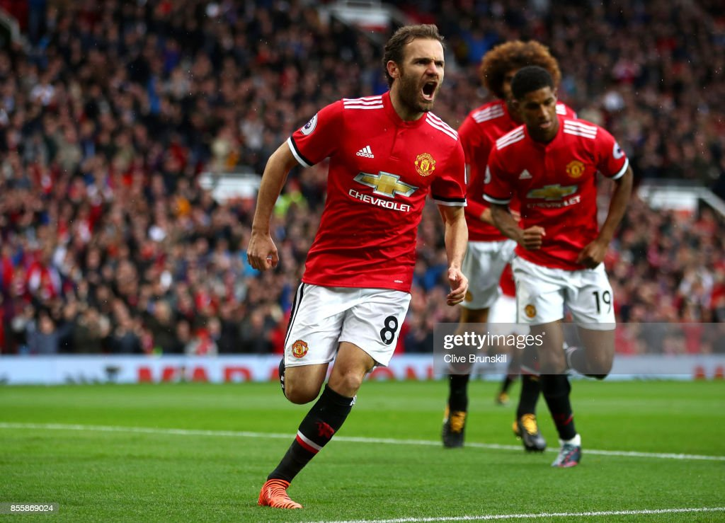 Juan Mata of Manchester United celebrates scoring the opening goal during the Premier League match between Manchester United and Crystal Palace at Old Trafford on September 30, 2017 in Manchester, England.