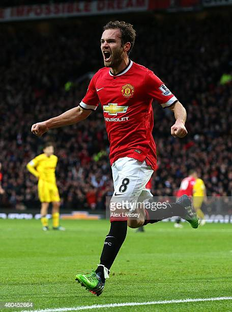 Juan Mata of Manchester United celebrates scoring the second goal during the Barclays Premier League match between Manchester United and Liverpool at...