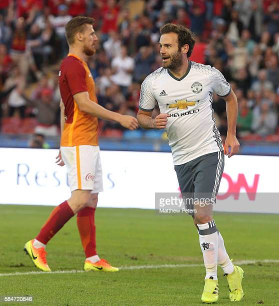 Juan Mata of Manchester United celebrates scoring their fifth goal during the preseason friendly match between Manchester United and Galatasaray at...