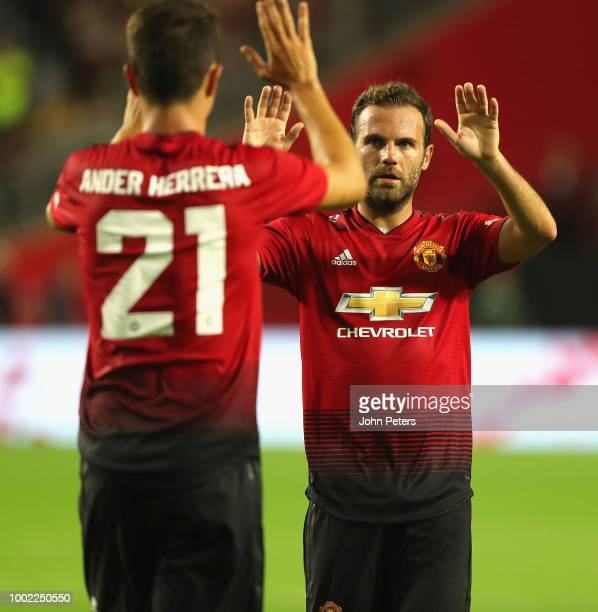 Juan Mata of Manchester United celebrates scoring their first goal during the pre-season friendly match between Manchester United and Club America at...