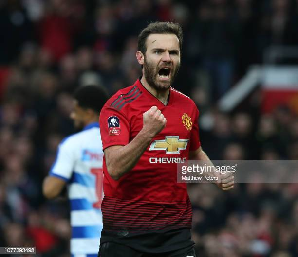 Juan Mata of Manchester United celebrates scoring their first goal during the FA Cup Third Round match between Manchester United and Reading at Old...