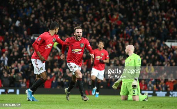 Juan Mata of Manchester United celebrates scoring their first goal during the FA Cup Third Round Replay match between Manchester United and...