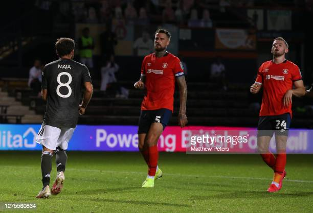 Juan Mata of Manchester United celebrates scoring their first goal during the Carabao Cup Third Round match between Luton Town and Manchester United...