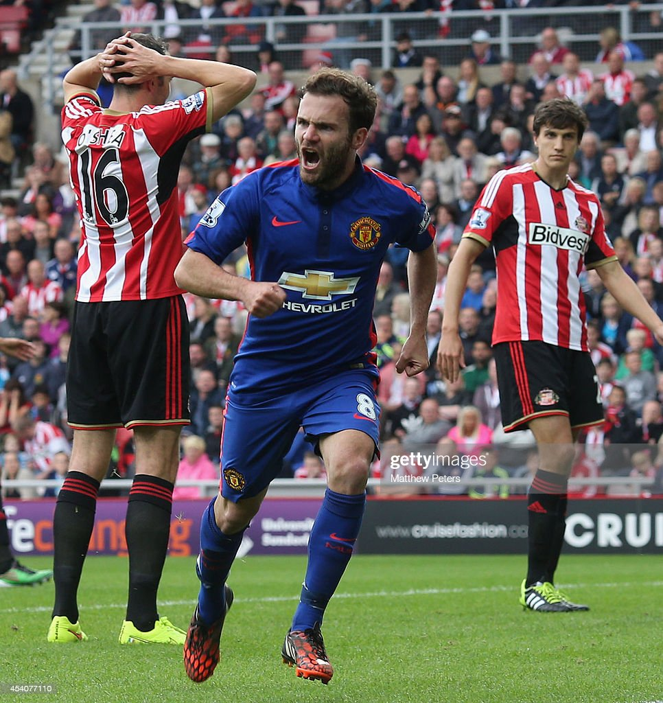 Juan Mata of Manchester United celebrates scoring their first goal during the Barclays Premier League match between Sunderland and Manchester United at Stadium of Light on August 24, 2014 in Sunderland, England.