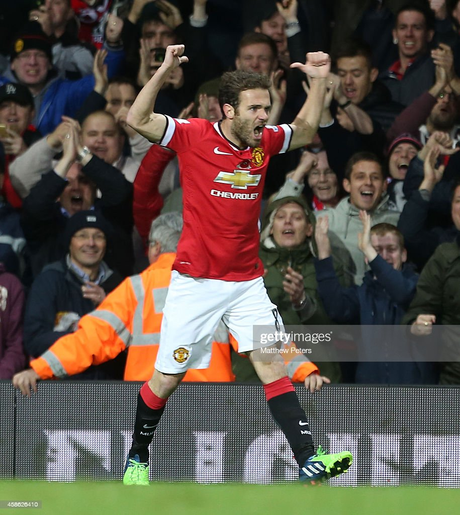 Juan Mata of Manchester United celebrates scoring their first goal during the Barclays Premier League match between Manchester United and Crystal Palace at Old Trafford on November 8, 2014 in Manchester, England.
