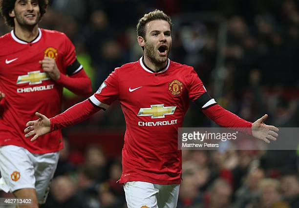 Juan Mata of Manchester United celebrates scoring their first goal during the FA Cup Fourth Round replay match between Manchester United and...