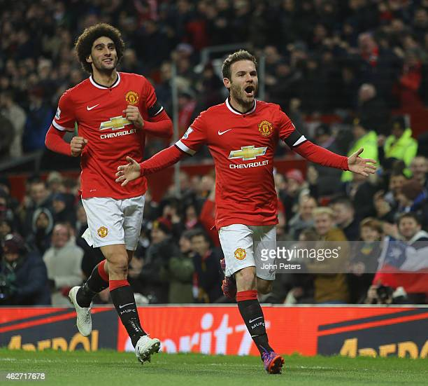 Juan Mata of Manchester United celebrates scoring their first goal during the FA Cup Fourth Round replay between Manchester United and Cambridge...