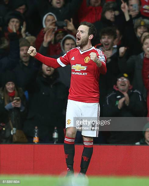 Juan Mata of Manchester United celebrates scoring their first goal during the Barclays Premier League match between Manchester United and Watford at...
