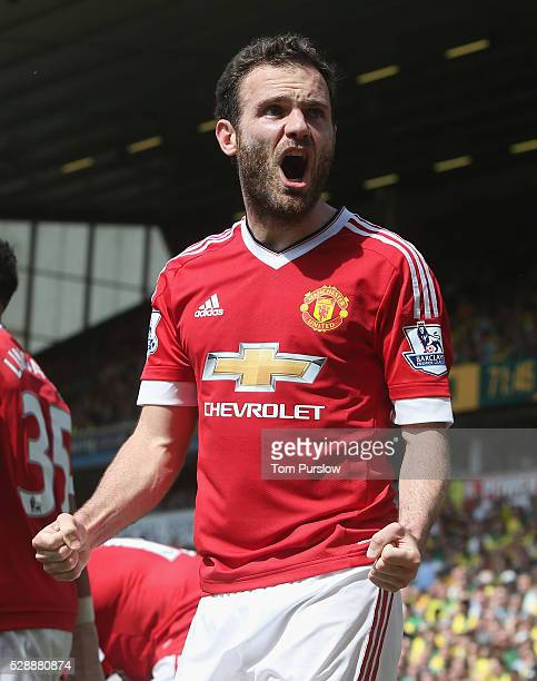 Juan Mata of Manchester United celebrates scoring their first goal during the Barclays Premier League match between Norwich City and Manchester...