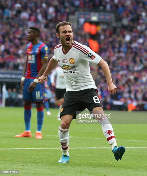 Juan Mata of Manchester United celebrates scoring their first goal during The Emirates FA Cup final match between Manchester United and Crystal...