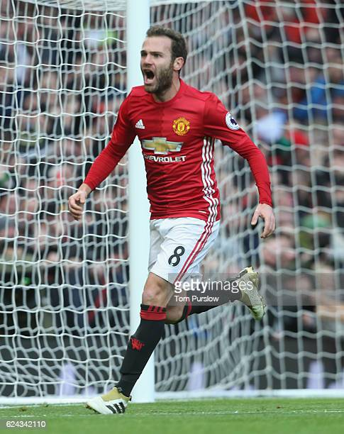 Juan Mata of Manchester United celebrates scoring their first goal during the Premier League match between Manchester United and Arsenal at Old...